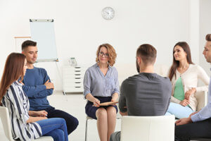 a group therapy session at a prescription drug addiction treatment program