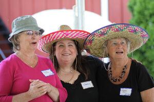 women celebrating in rehab alumni program