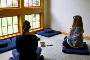 women meditating as part of mbrp therapy program