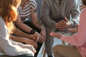 group talking in anger management therapy program